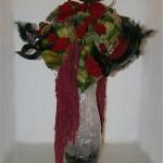 Feuilles de cordyline, célosie et roses rouges, sedums et amarantes queue de renard: 1er prix de la categorie Carnavals.