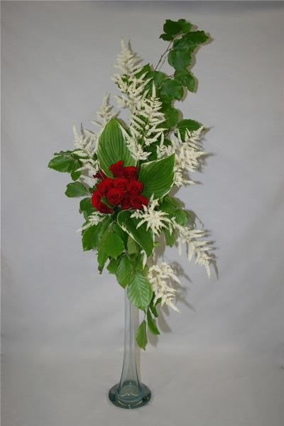 Le bouquet hogarth se construit, idéalement, sur une haute flûte en verre. Il doit être haut et élancé.