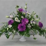 Des textures végétales complémentaires créent un bouquet classique romantique.