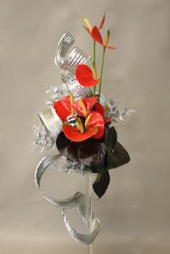 Le petit feuillage complète fleurs et feuilles d'anthurium.