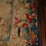 Détail d'une tapisserie de Bruxelles du XVIIème siècle illustrant le mythe de l'alternance des saisons.Les très belles bordures, typiques de Bruxelles représentent des guirlandes de fruits et de fleurs sortant de cornes d'abondance.