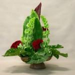 Bouquet vert de Mollucelles, feuilles rondes d'Aralia et Cordylines.