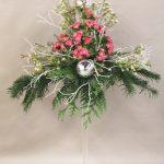 Noël en rose avec une masse d'oeillets de poète et du wax.